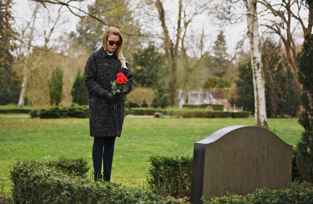 grieving, at a gravesite.jpg