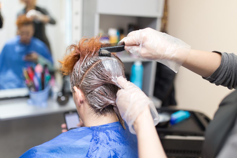 woman getting hair dye