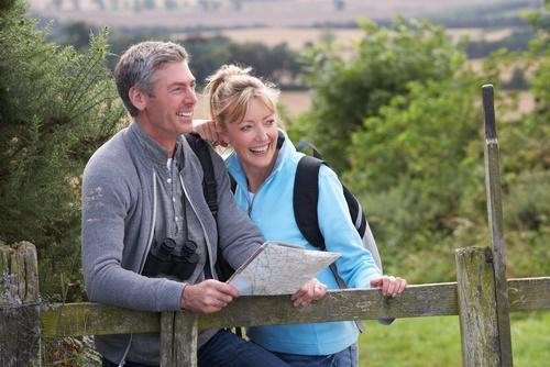 happy older couple hiking