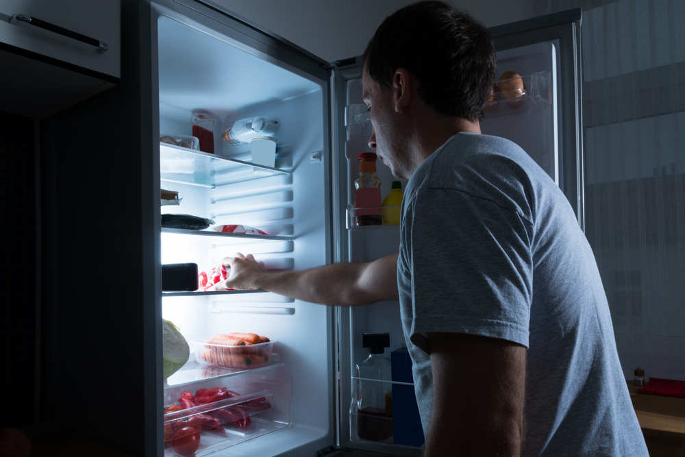 man eating from refrigerator.jpg