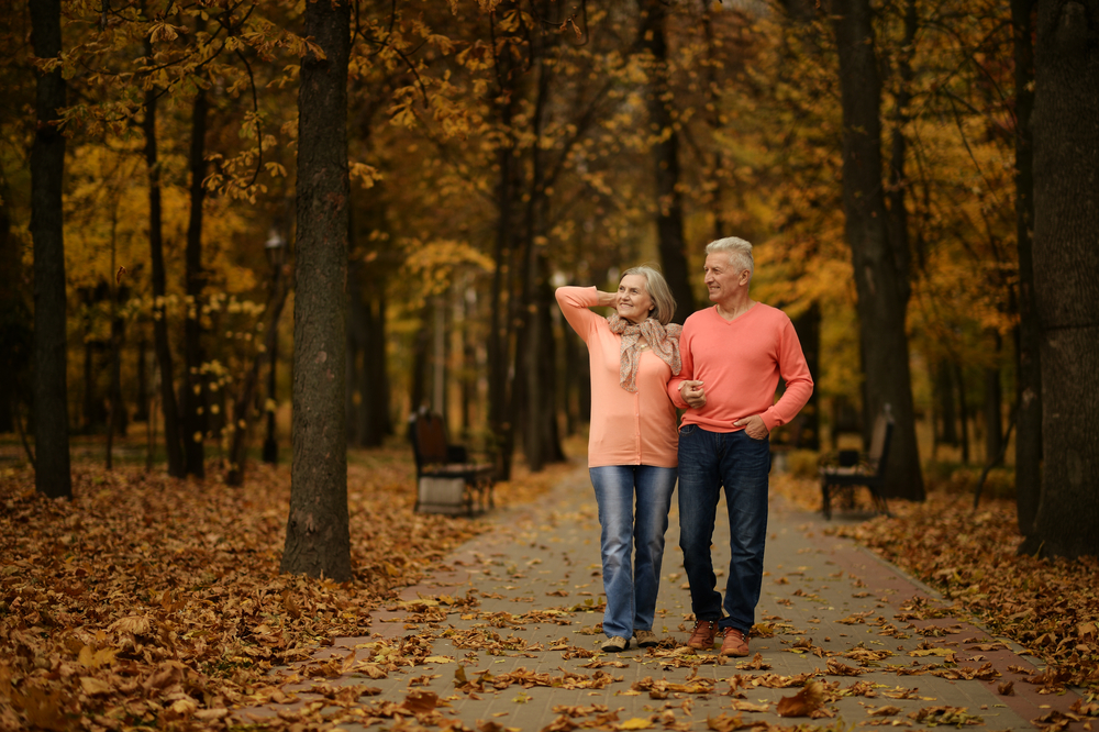mature couple walking in autumn.jpg