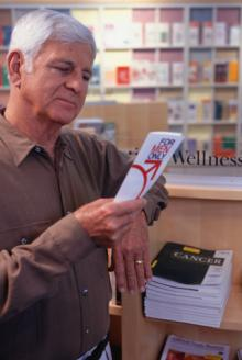 mature man looking at medical brochure, prostate.jpg