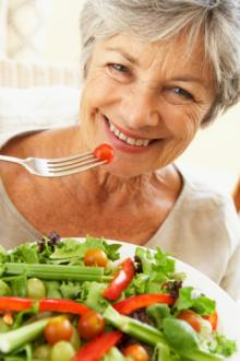 mature woman eating salad.jpg