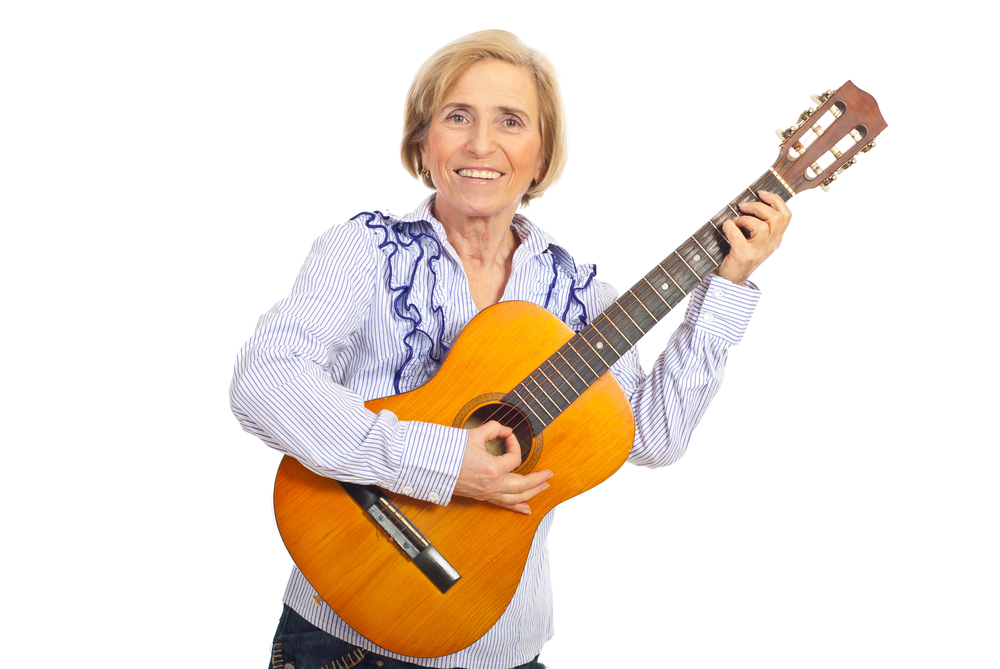 mature woman playing a guitar.jpg