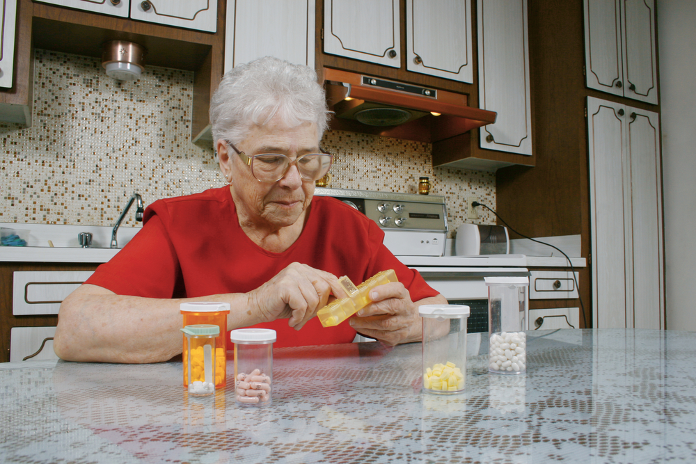 mature woman taking pills.jpg