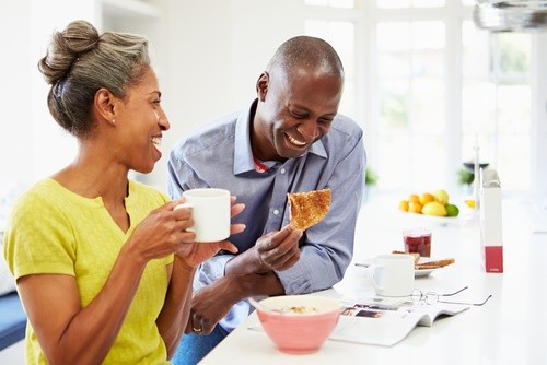 mature African American couple kitchen