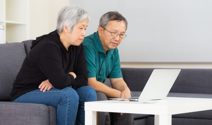 mature-Asian-American-couple-concerned.jpg