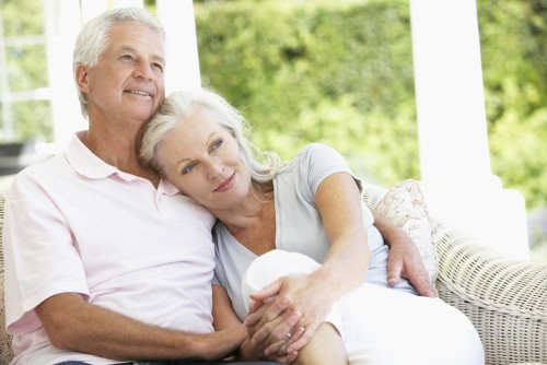 mature couple at home on porch