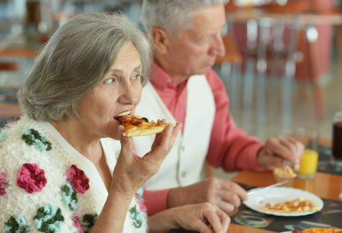 mature-couple-eating-pizza