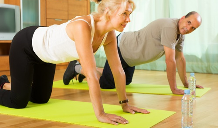 mature-couple-exercising-home.jpg