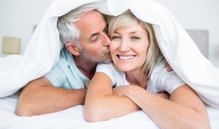 mature couple happy in bed