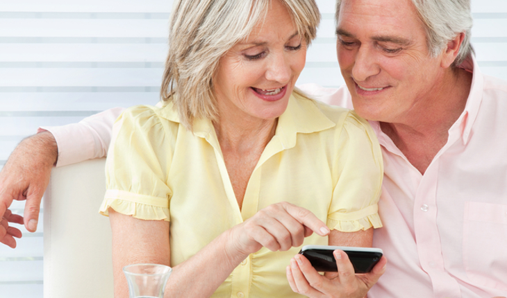 mature couple smart phone, social media
