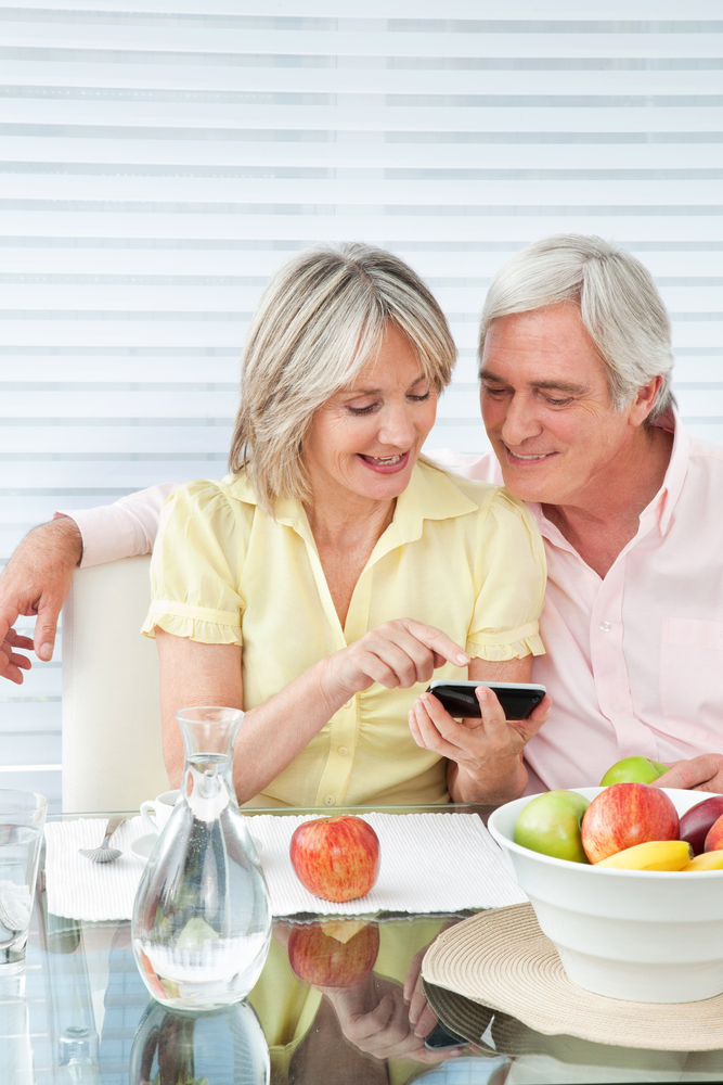 mature couple smart phone, social media