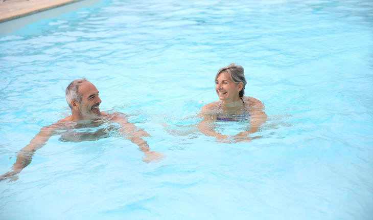 mature-couple-swimming