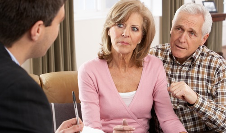 mature couple with financial adviser