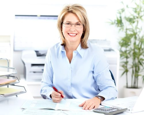 mature happy woman at office