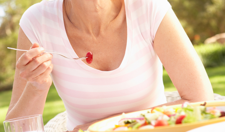 mature woman eating healthy food