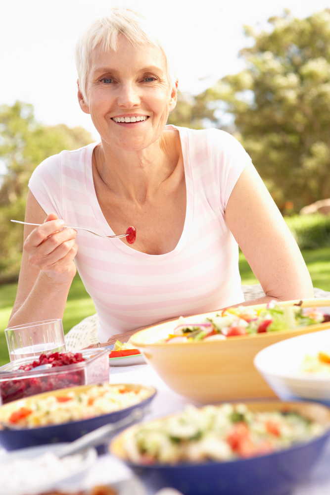 mature woman eating healthy food