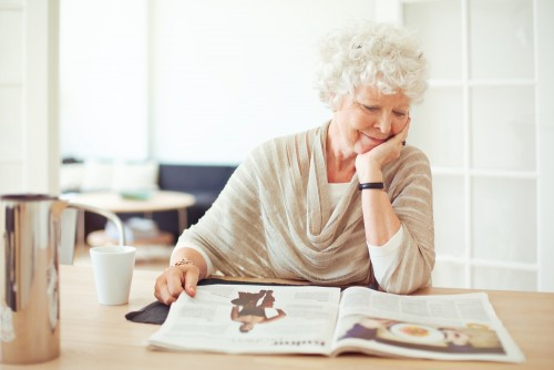mature woman reading a magazine
