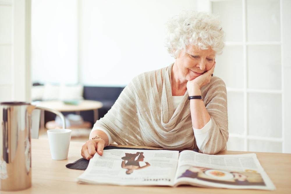 mature woman reading a magazine