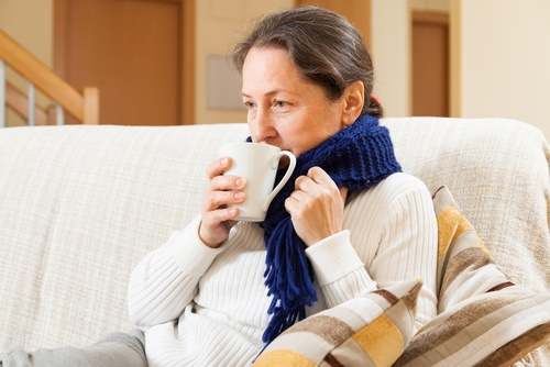 mature woman winter couch
