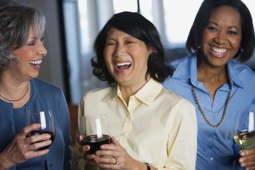 multienthic women drinking wine
