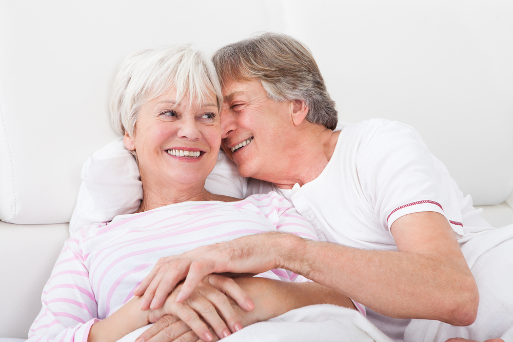 older couple in bed, making love.jpg