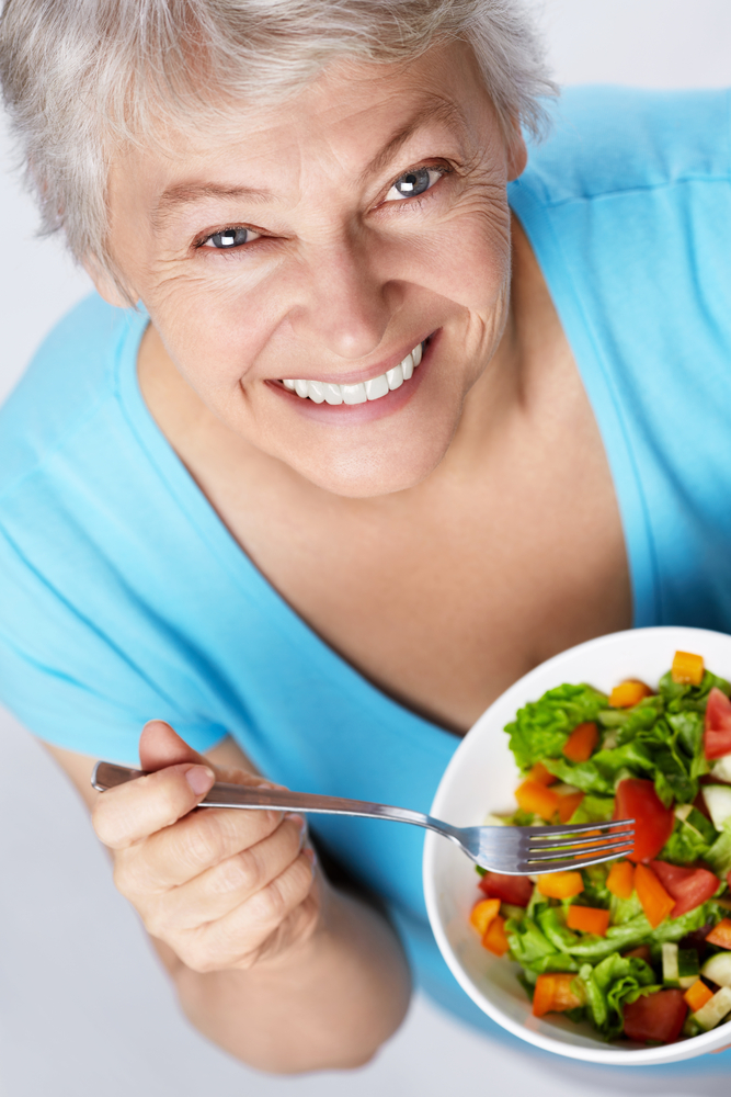 older woman eating salad.jpg