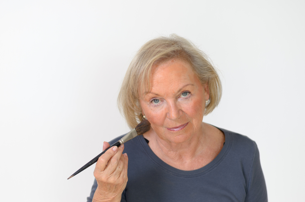 older woman with makeup brush.jpg