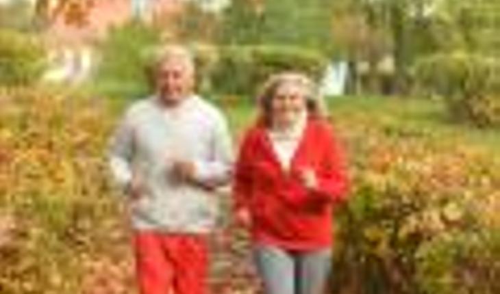 older cojuple running in autumn