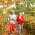 older cojuple running in autumn
