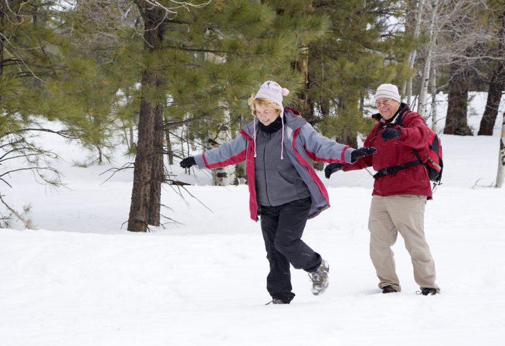 older couple walking in wintr