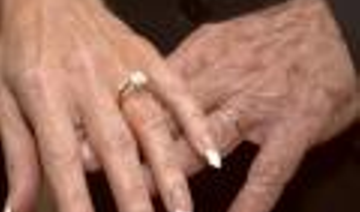older hands with wedding rings