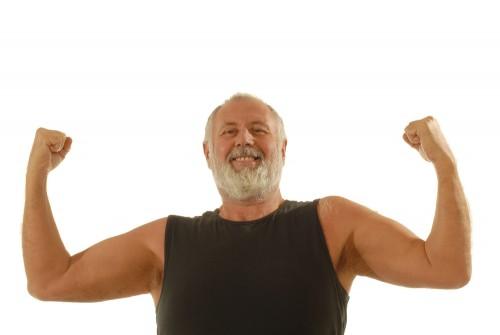 older man flexing biceps