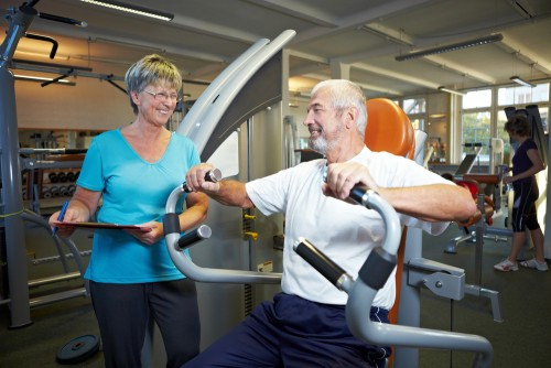 older man on rowing machine