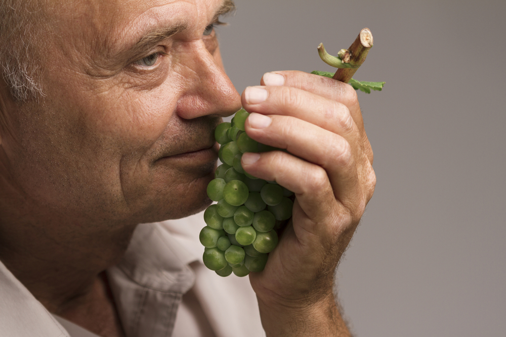 older-man-smelling-grapes