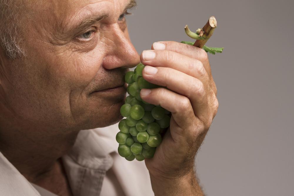 older-man-smelling-grapes