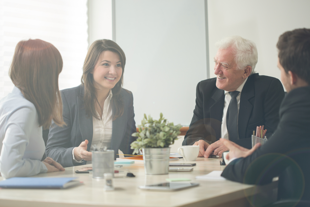 older-person-in-office-with-younger-people