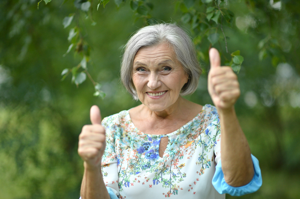 older woman thumbs up