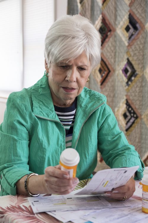 older-woman-with-pills