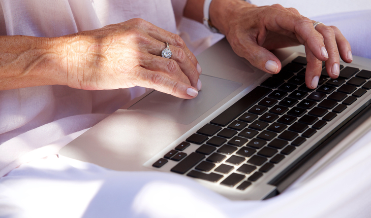 older-womans-hand-at-computer