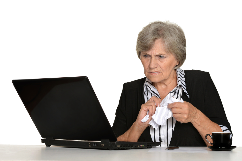 oldersomean sad at computer.jpg
