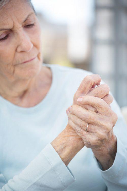 olderwoman in pain hands