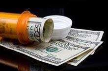 prescription-pill-bottle-and-money.jpg
