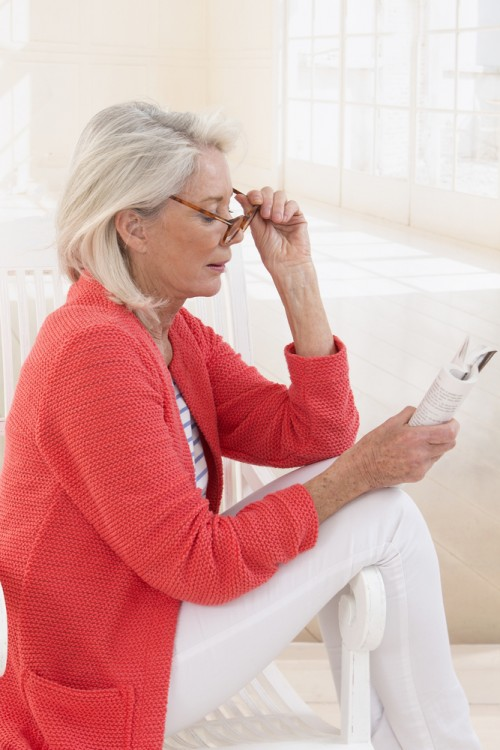 woman with reading glasses