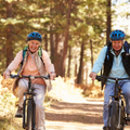 senior couple cycling
