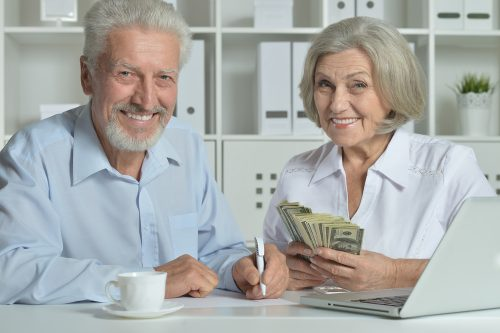 senior-couple-with-money