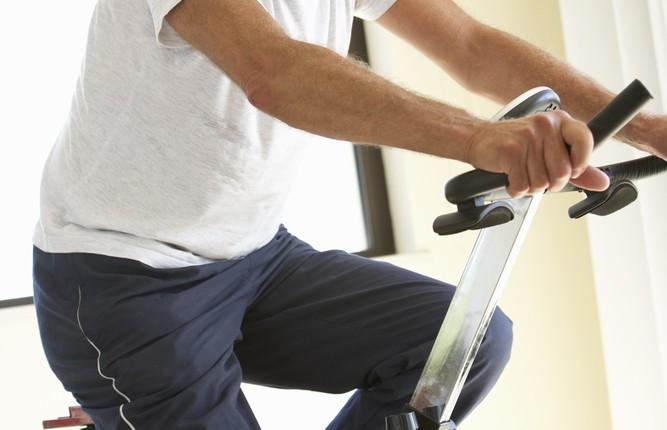 senior man, exercise bike