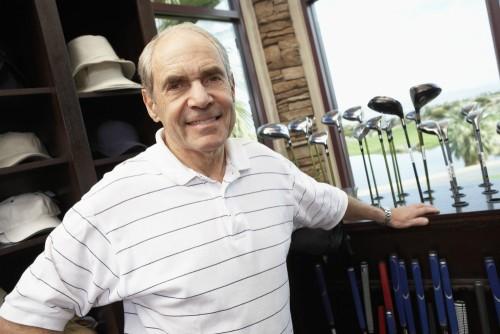 senior man in golf shop