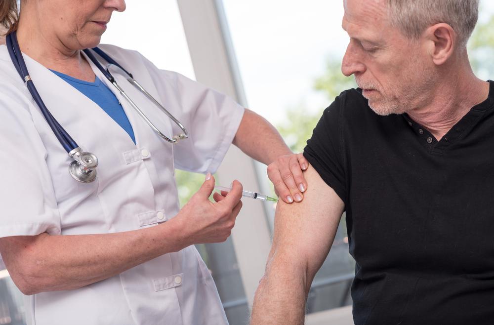 senior man vaccination